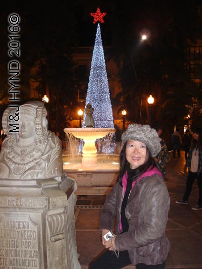 spain elche Fiesta Belen Christmas Nativity, lit-up Christmas tree, fountain, statue Dama de Elche