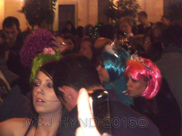 spain downtown Alicante, fiesta nochevieja New Years Eve, revellers party dress, multi-coloured wigs