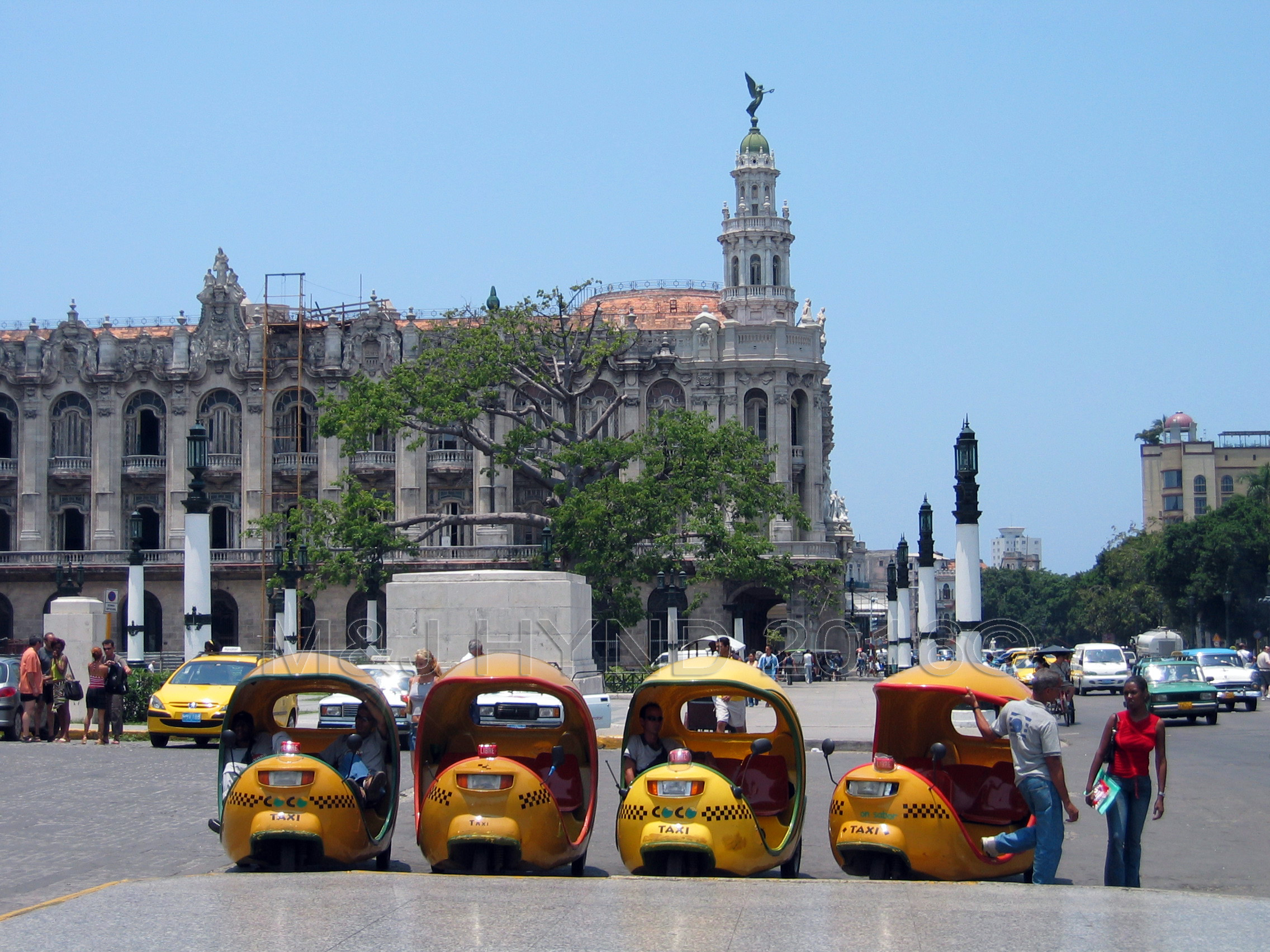 coco-taxis, egg-shaped, three-wheeler in the shape of a yellow coconut, downtown Havana, cuba worldwide holiday ideas