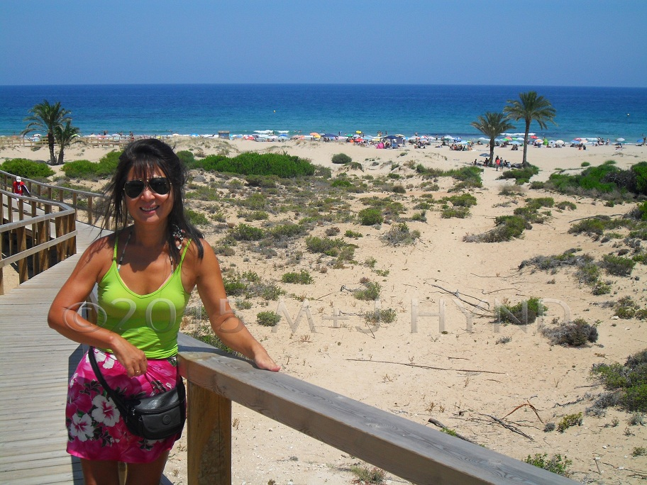 spain sand dune beaches, palm trees, blue Mediterranean sea