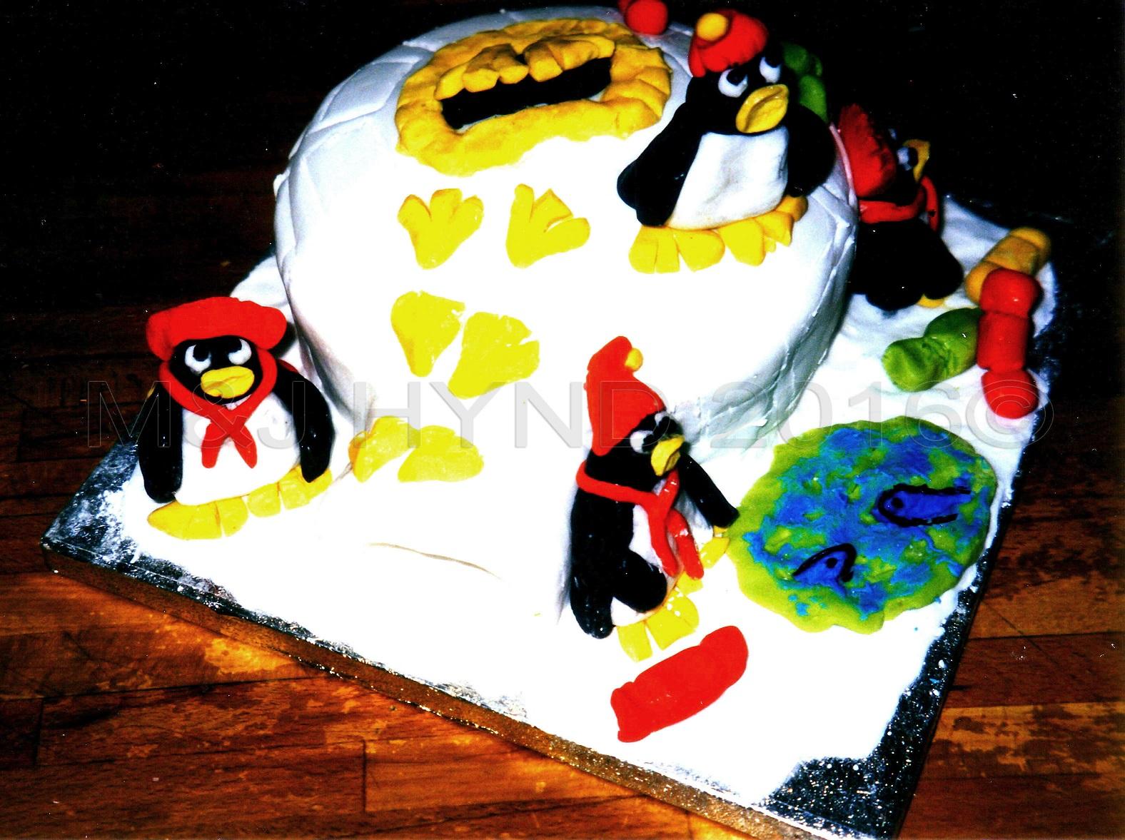 one-handed penguin Christmas cake, London, UK