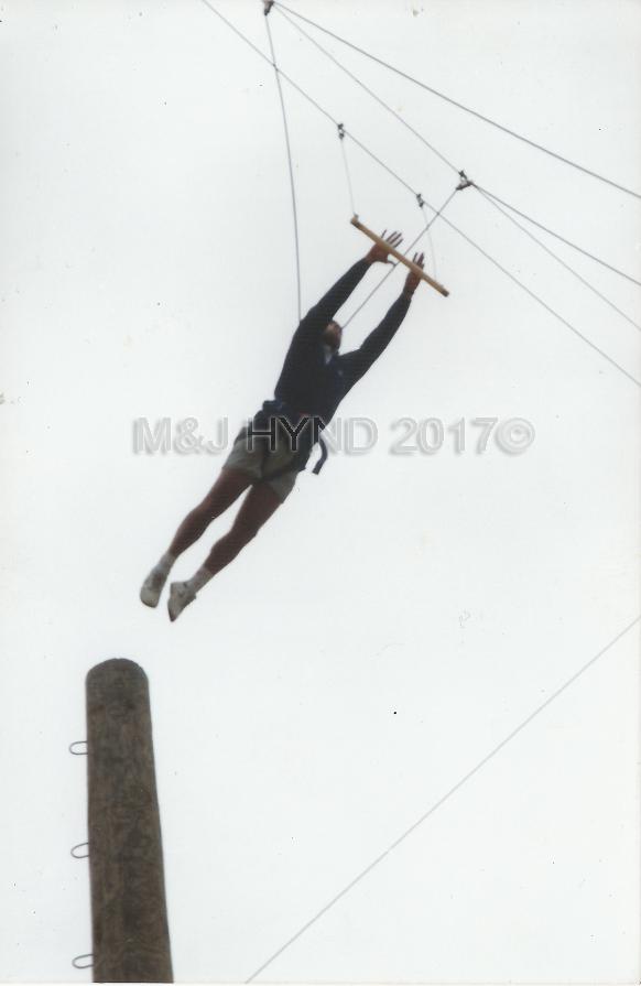 Rock+Ropes, midflight to the trapeeze bar, Taupo, NZ