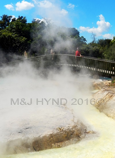 bridge over steaming waters, Wairekei Terraces, Geothermal Valley, Taupo, NZ
