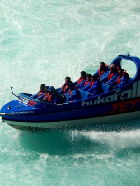 Huka Falls jetboat in action closeup, Taupo, NZ