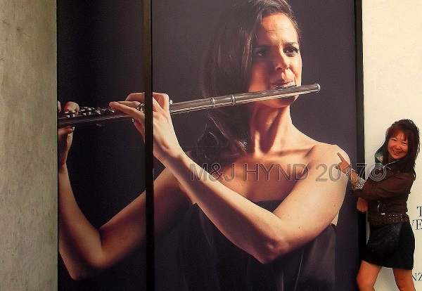 flautist poster for Philharmonic orchestra event, Wellington, NZ