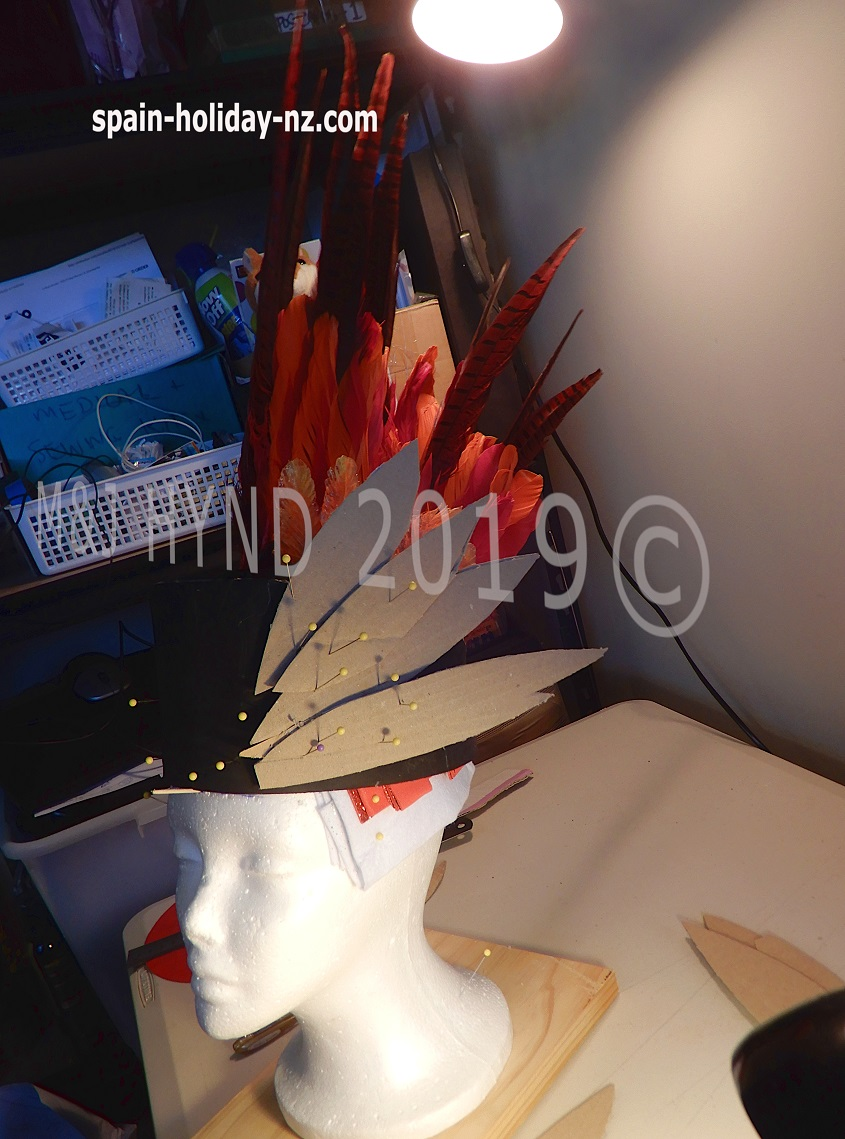 13: headpiece feathers, worbla, cardboard