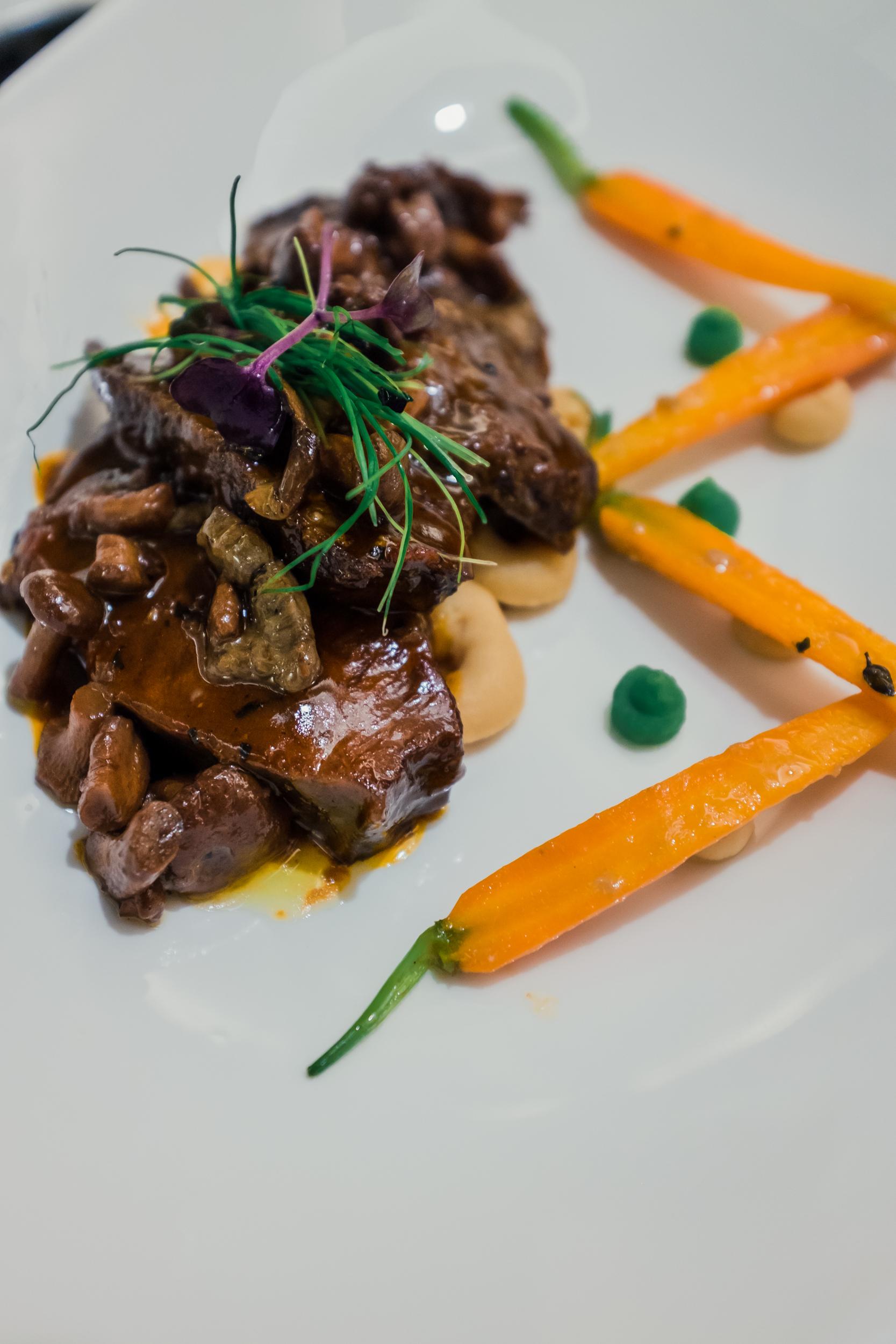Slow Braised Wagyu Beef Cheek With Creamy Mash, Chanterelle Mushrooms and Veggies