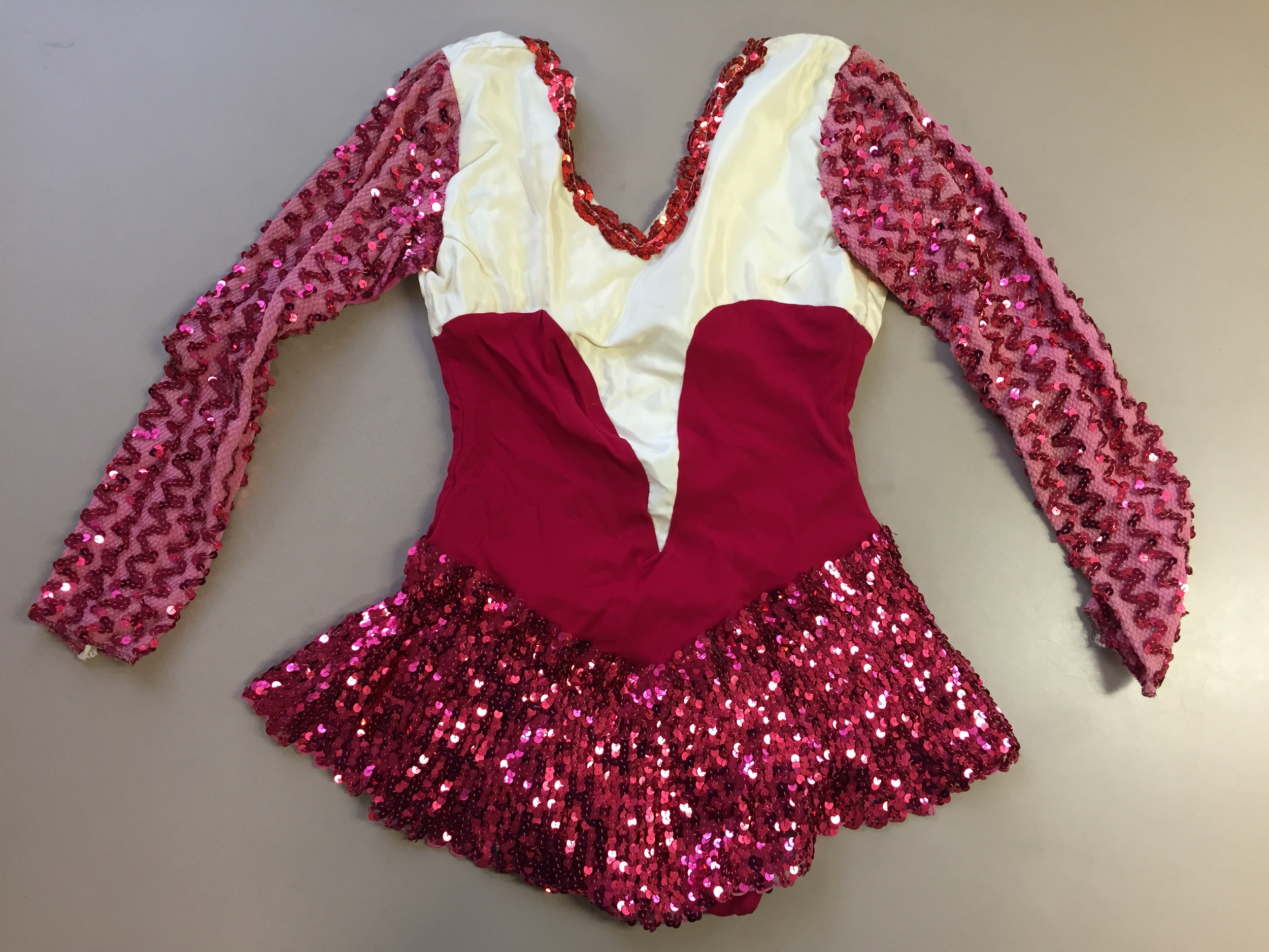 Sparkling white and magenta uniform, late 1970's, from Baltimore, MD. Donated to the Moorland-Spingarn Collection at Howard University.