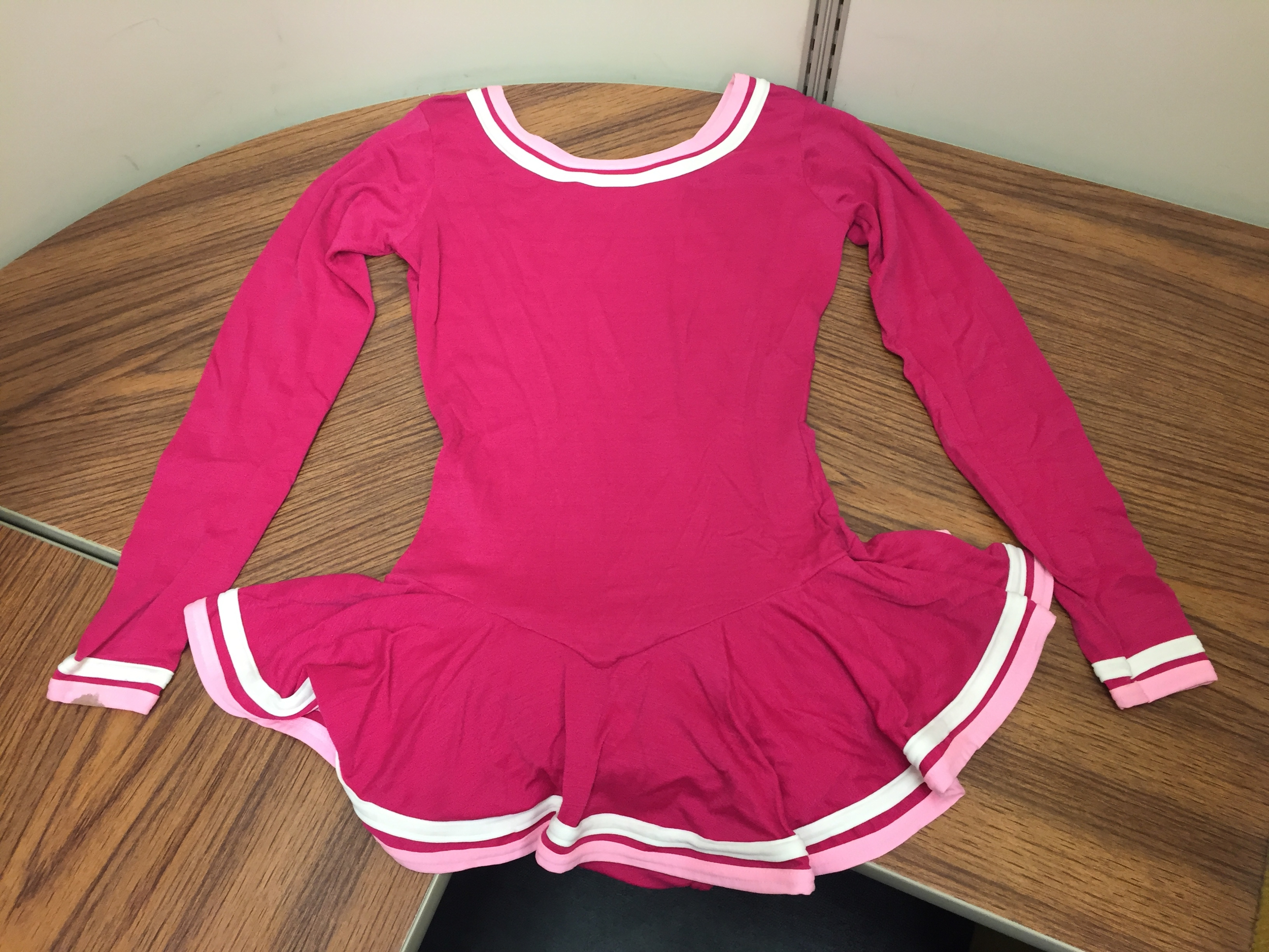 Vibrant Pink and white roller dress worn by local DC skater and instructor Connie Pollard, donated to the Moorland-Spingarn Research Center at Howard University.