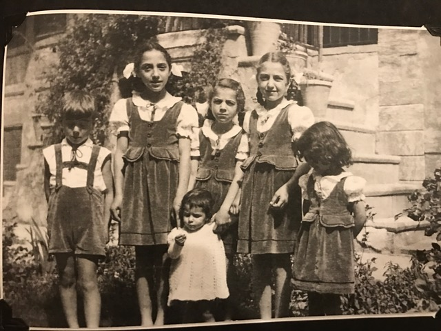 My mom (top row, in the middle) with her siblings, Mosul, Iraq, circa 1950