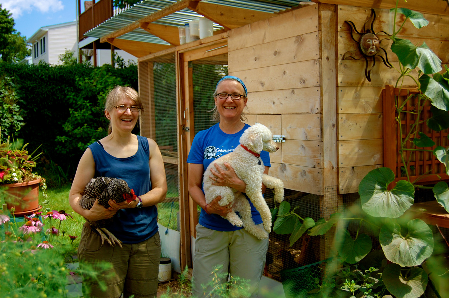 Happy customers enjoying one of our handmade chicken coops!