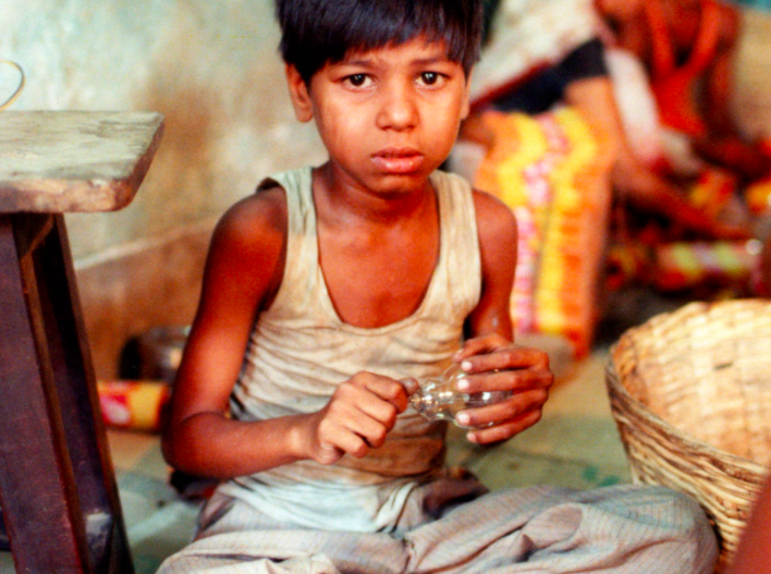 INDIA: LIGHTBULB FACTORY WOrkerS - Youngsters trafficked from poor rural areas to the city, are held and forced to work up to 20 hours a day without pay. The ILO estimates that six million children world-wide are forced into this type of child labor. ©Robin Romano