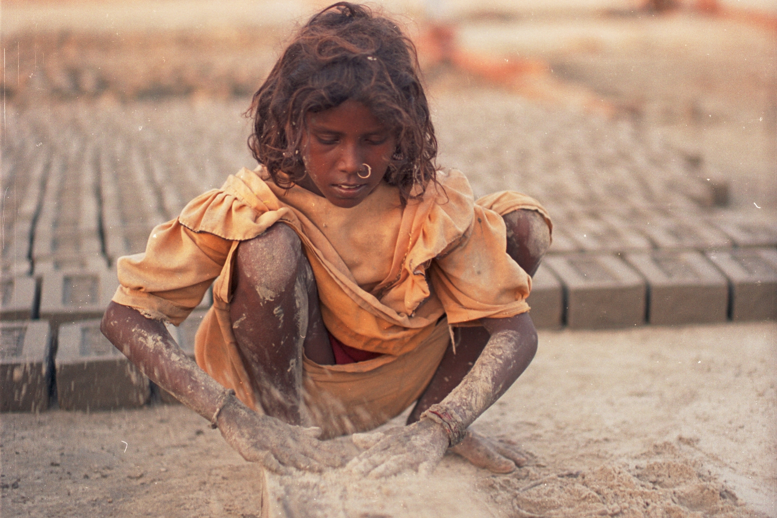 INDIA: BRICKMAKERS - Thousands of brick kilns line the riverbanks in Bengal and the surrounding states of India. The families that work here are exploited 12-16 hours a day, 7 days a week. ©Robin Romano
