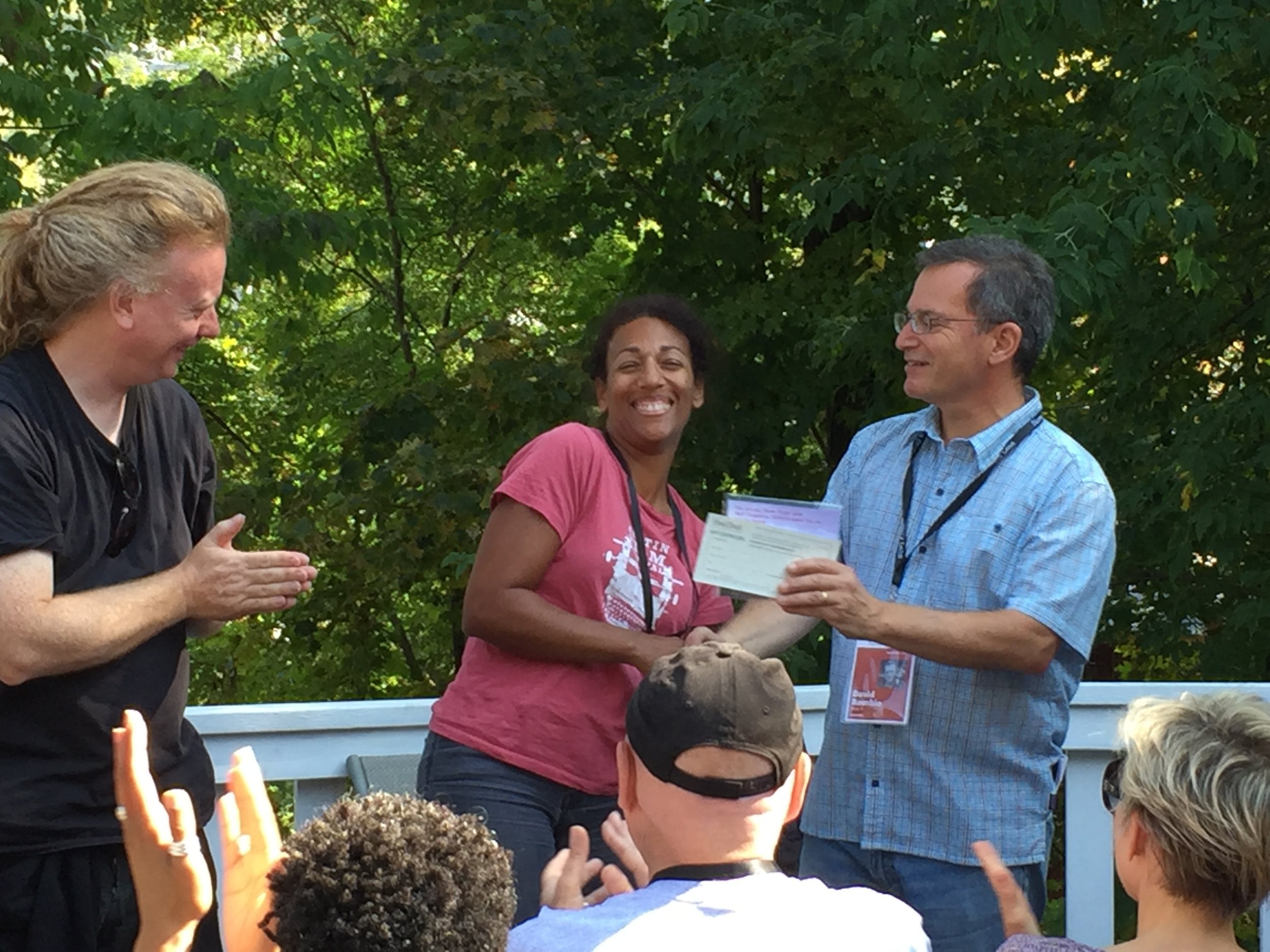Melody Cooper being awarded Stowe Story Labs / Tangerine Entertainment Fellowship, Fall 2017, with Stowe Story Labs Founders David Pope and David Rocchio