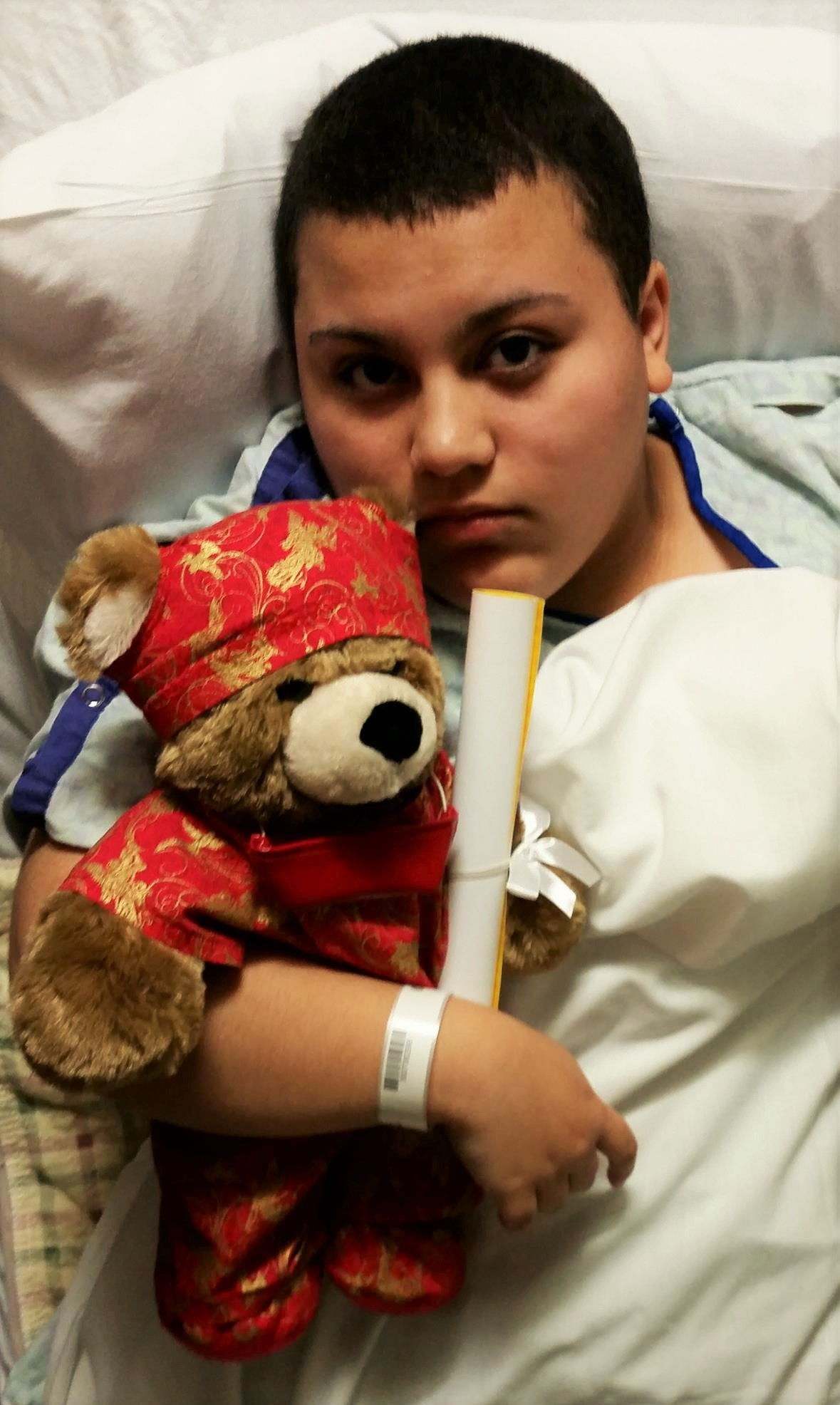 Heading into surgery with her Surgery Build A Bear from her Surgeon...  His name is Zan (meaning providing support)