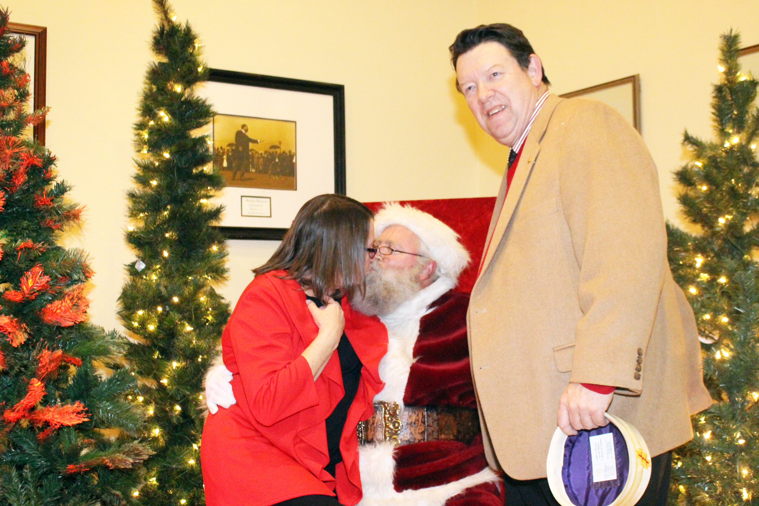 Deb and John Maxell with Santa Claus.JPG
