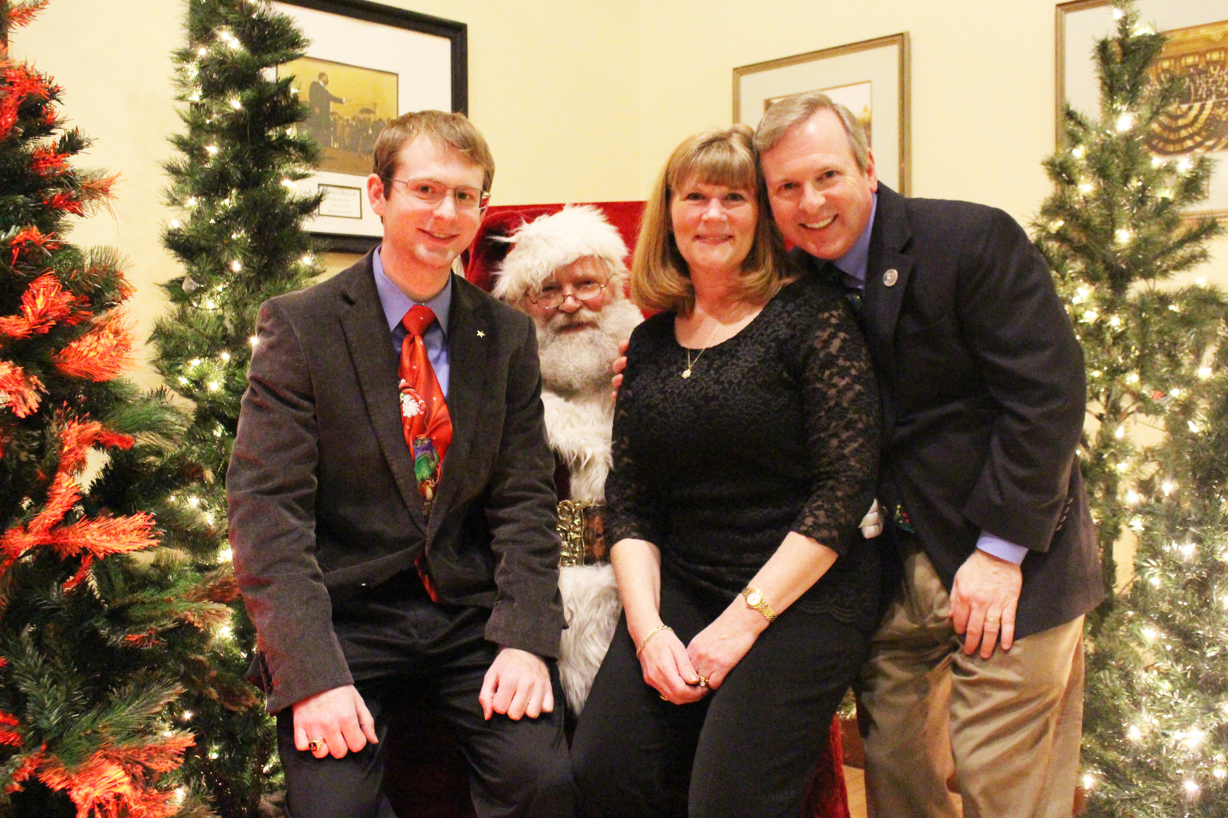 Brandon Elizabeth and Eric Van Sky with Santa.JPG
