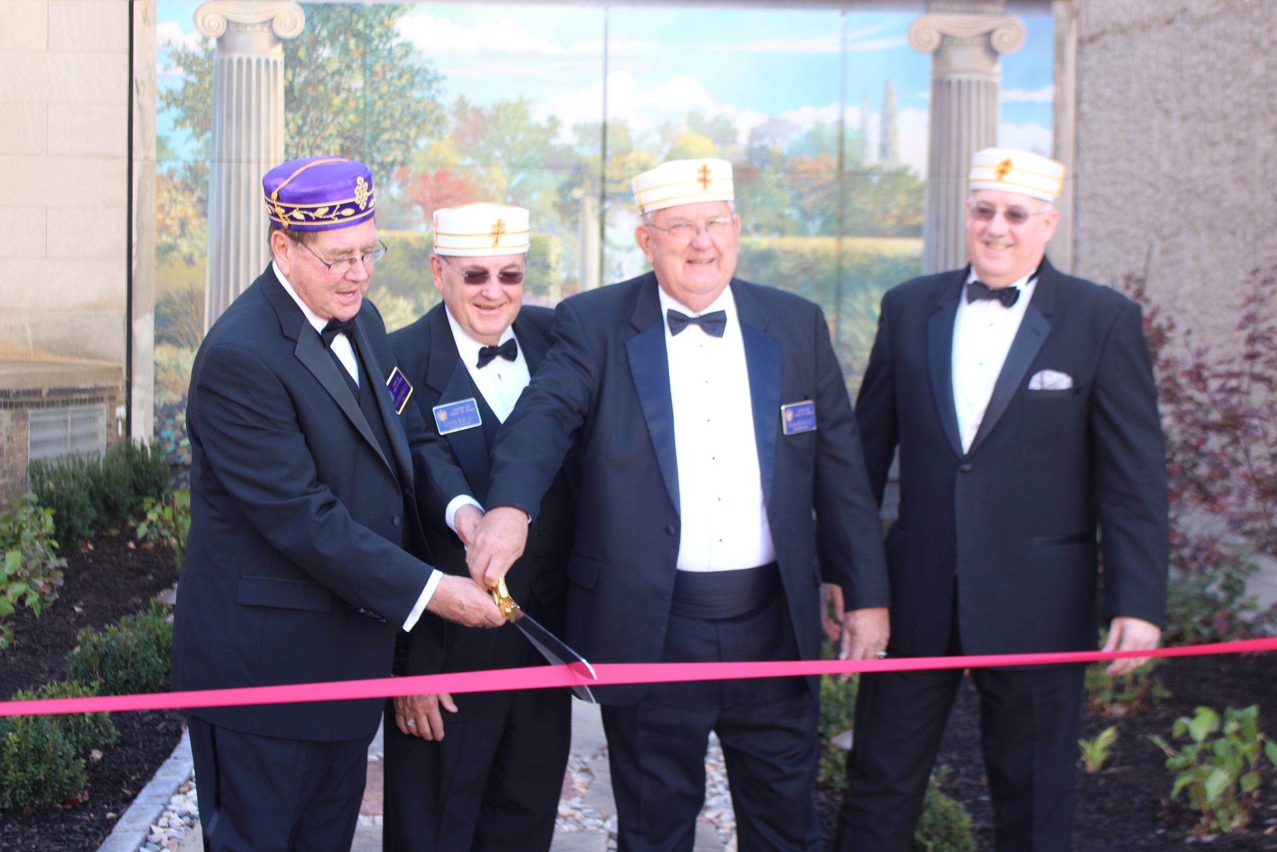 Charles Sederstrom, 33°, SGIG in Nebraska, with Curt Edic, 33°, General Secretary, Frank Kroupa, 33°, President of the Omaha Valley Cathedral Board, and Paul Rutherford, 33°, Personal Representative to the SGIG dedicate the Scottish Rite Mural and Garden in October, 2015.