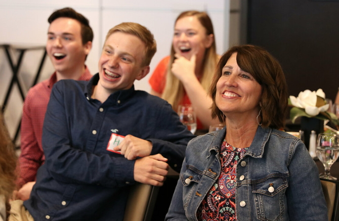 Anita Padgett, adviser of The Verve, and staff members react to the announcement of The VerveCast's superior rating in the General Excellence contest.