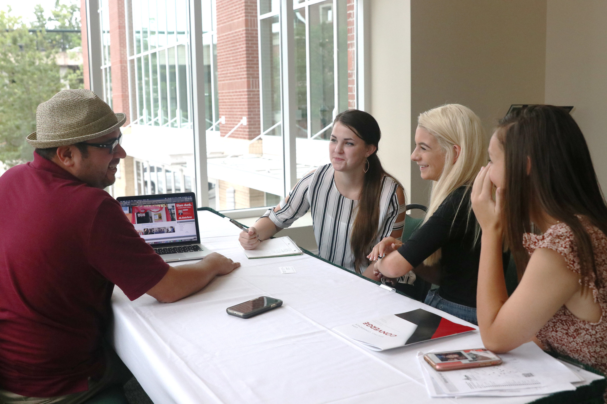 Students speak with Dr. Joe Dennis of Piedmont College during on-site critiques at the Georgia Scholastic Press Association (GSPA) Fall Conference on Thursday, Sept. 19, 2019. High school publication leaders had the opportunity to receive feedback from media professionals about their newspapers, news websites and newsmagazines in addition to attending sessions. GSPA hosted 40 sessions during the conference. Photo: Sarah Freeman/UGA Grady College