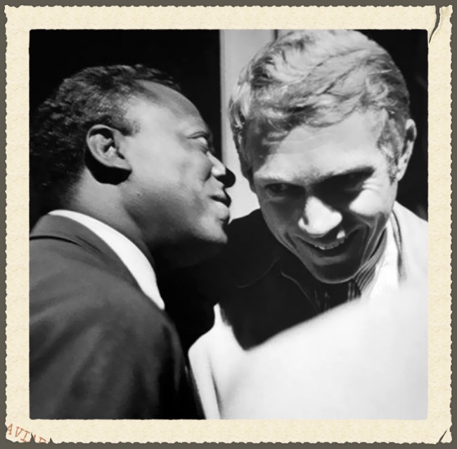 Miles Davis and Steve McQueen, backstage at the Monterey Jazz Festival 1963.