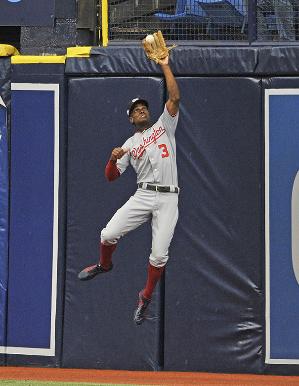 Nationals center fielder Taylor makes a leaping catch at the wall