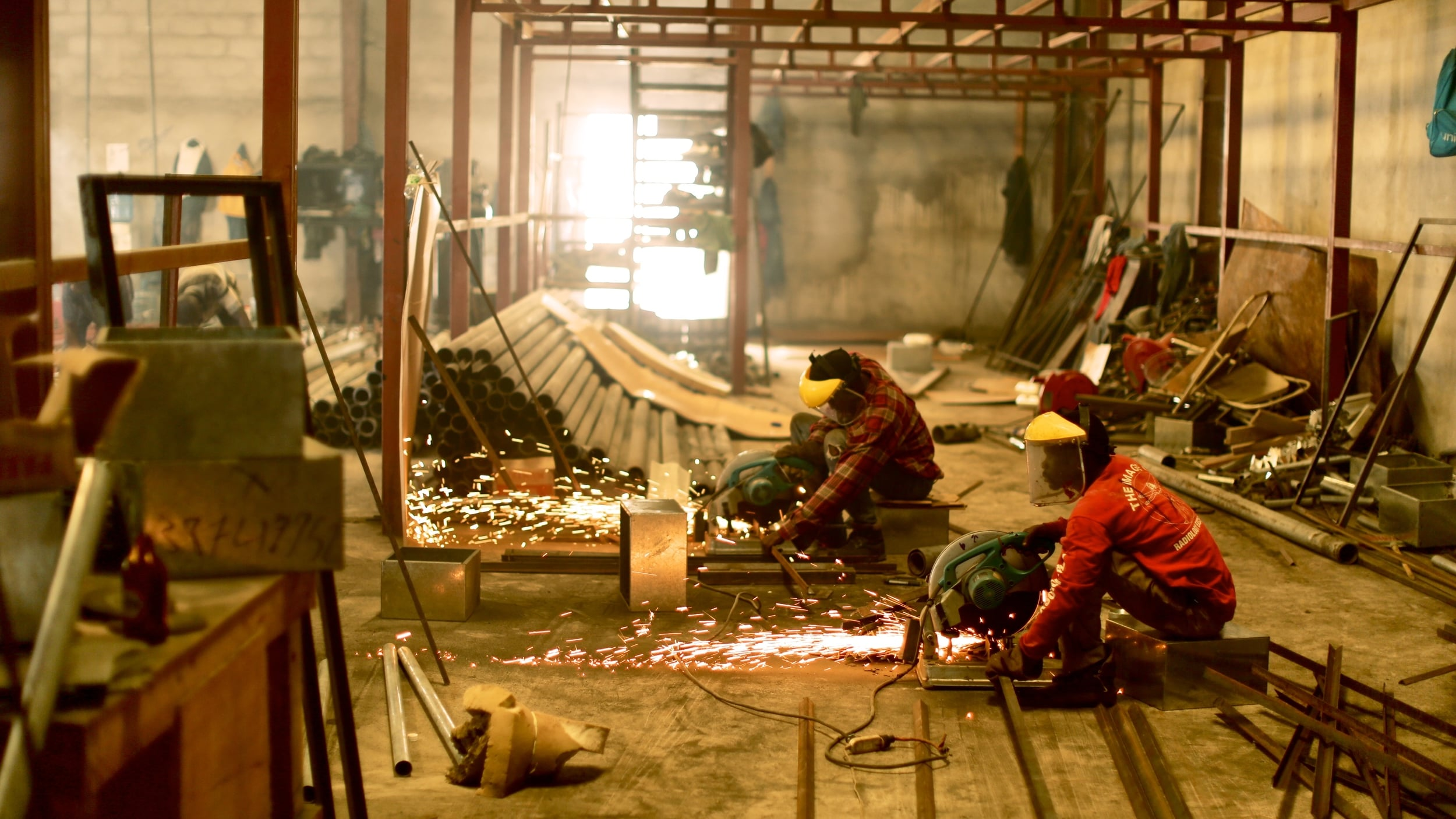 Still from Poverty INC. Haiti Enersa Factory. Credit: Mark Weber.