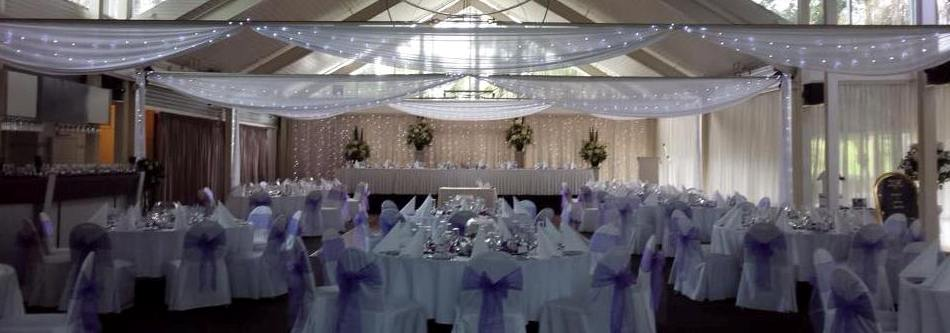 White silk ceiling drapes with fairy lights by Fairytale Events - Colebee Centre