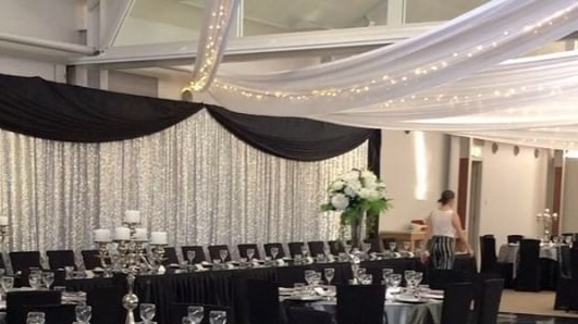 White silk drapes, fairy lights, sequin backdrop & swag, linen & chargers by Fairytale Events - Caves Coastal