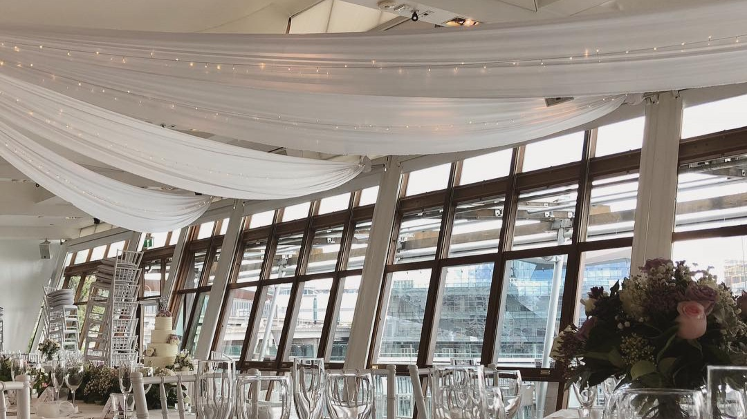 White silk drapes with fairy lights by Fairytale Events - LaAqua Dockside