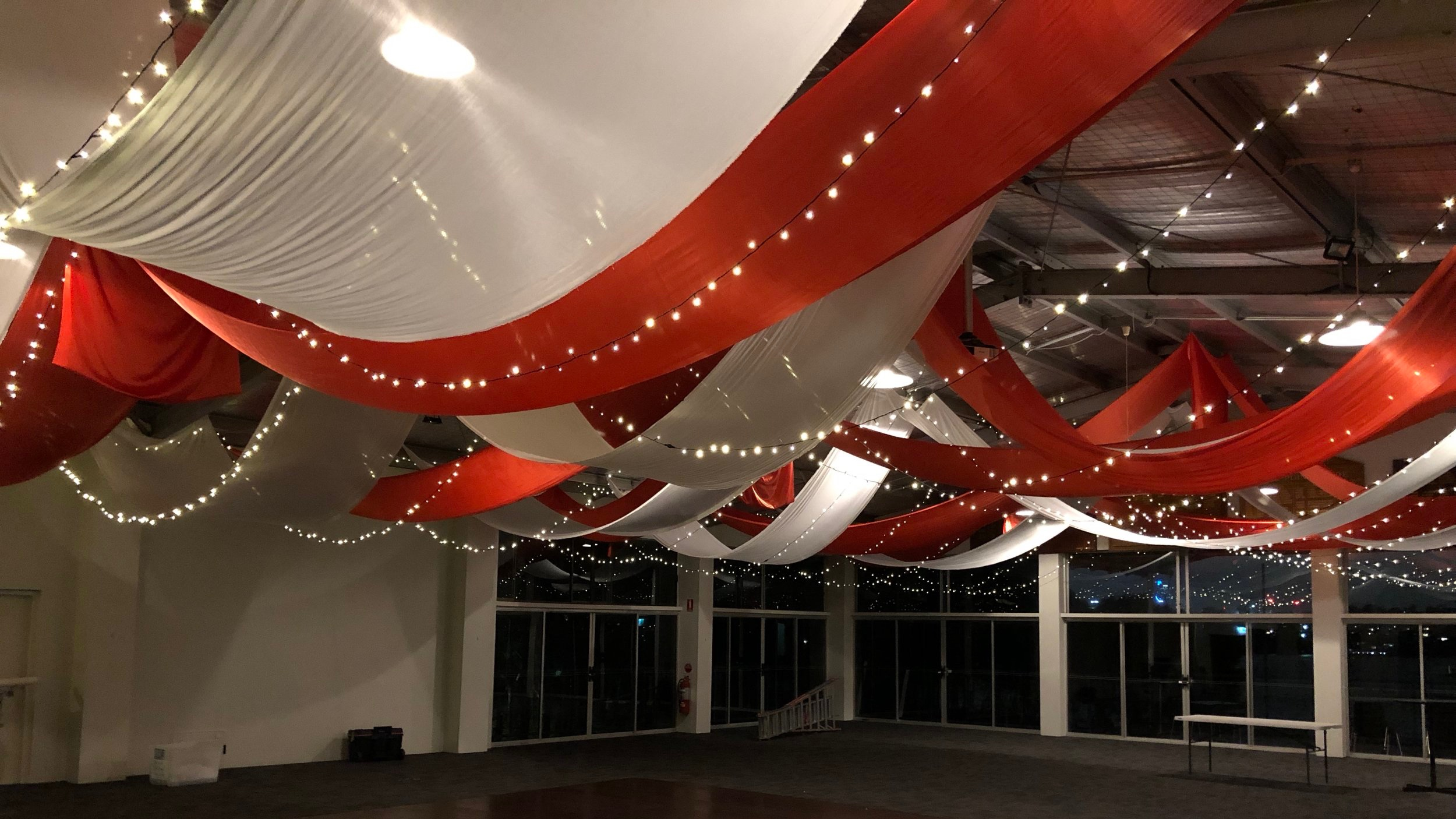 Coral and white silk ceiling drapes with fairy lights by Fairytale Events - Hunters Hill Sailing Club