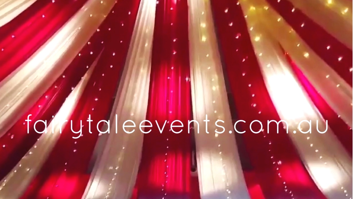 Red & white circus themed ceiling draping by Fairytale Events - Sydney University
