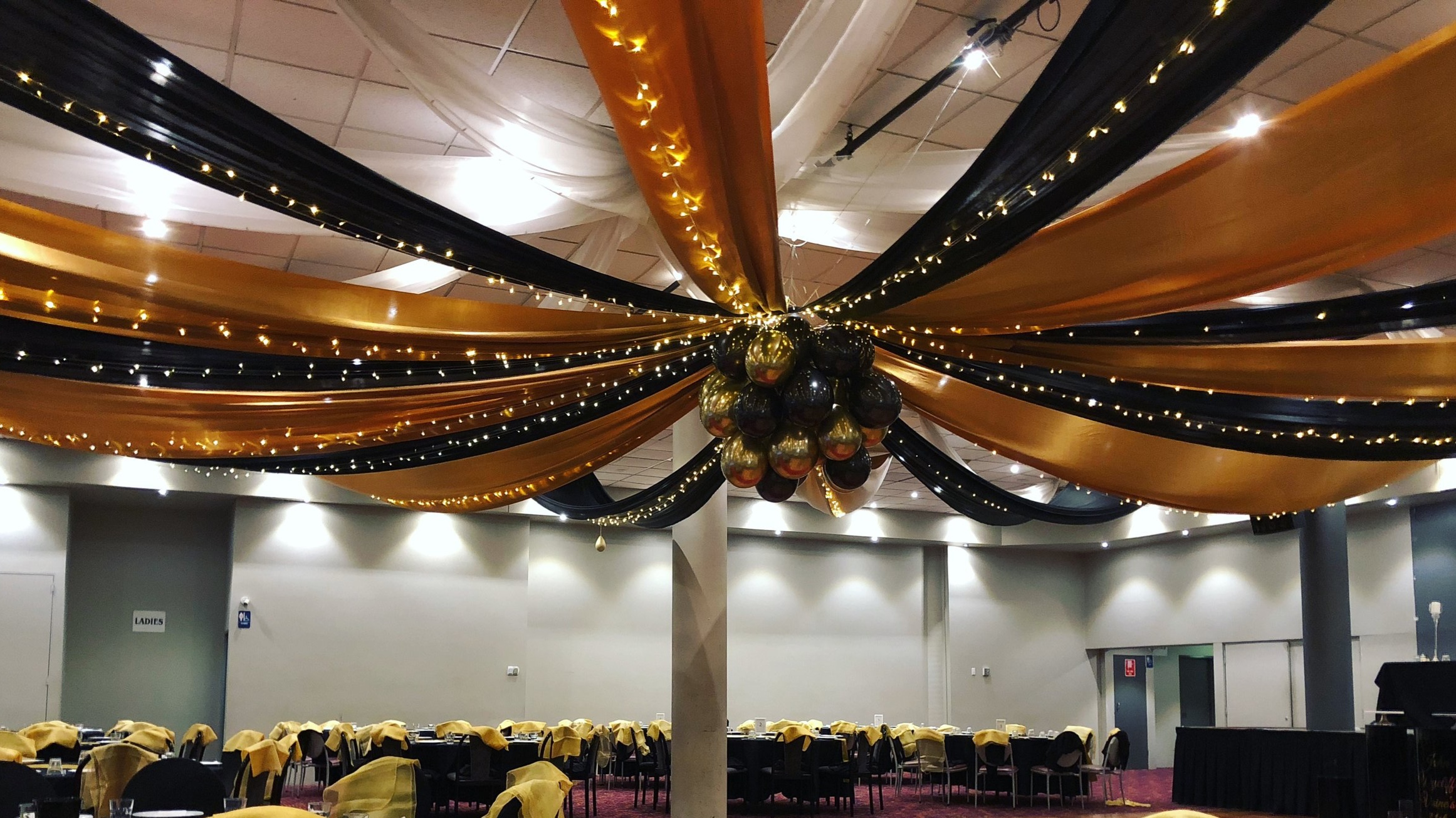 Black and gold silk drapes with fairy lights and balloon centre by Fairytale Events - The Croatian Club Punchbowl