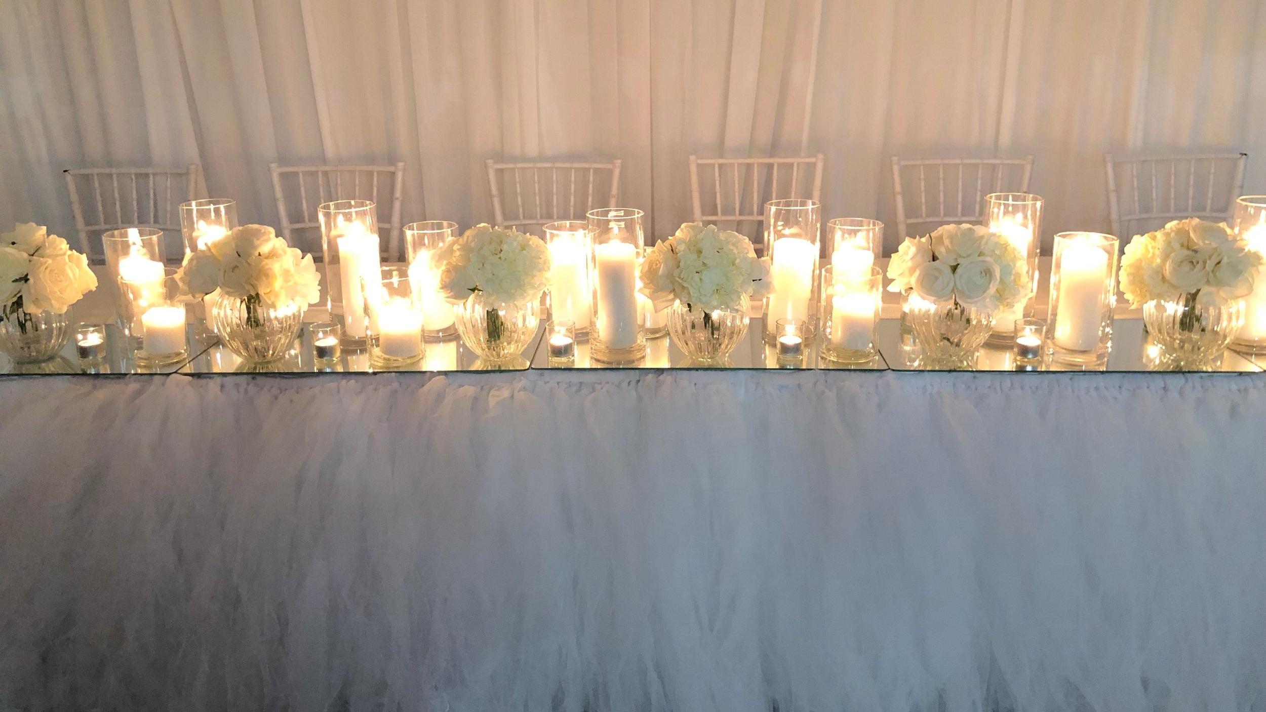 Eve bridal table decor including pillar candle upgrade