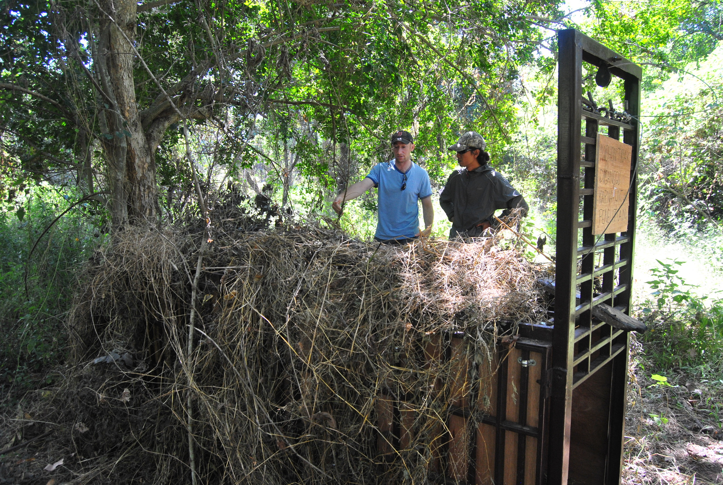 Andrew and Wahyudi discuss the leopard trap