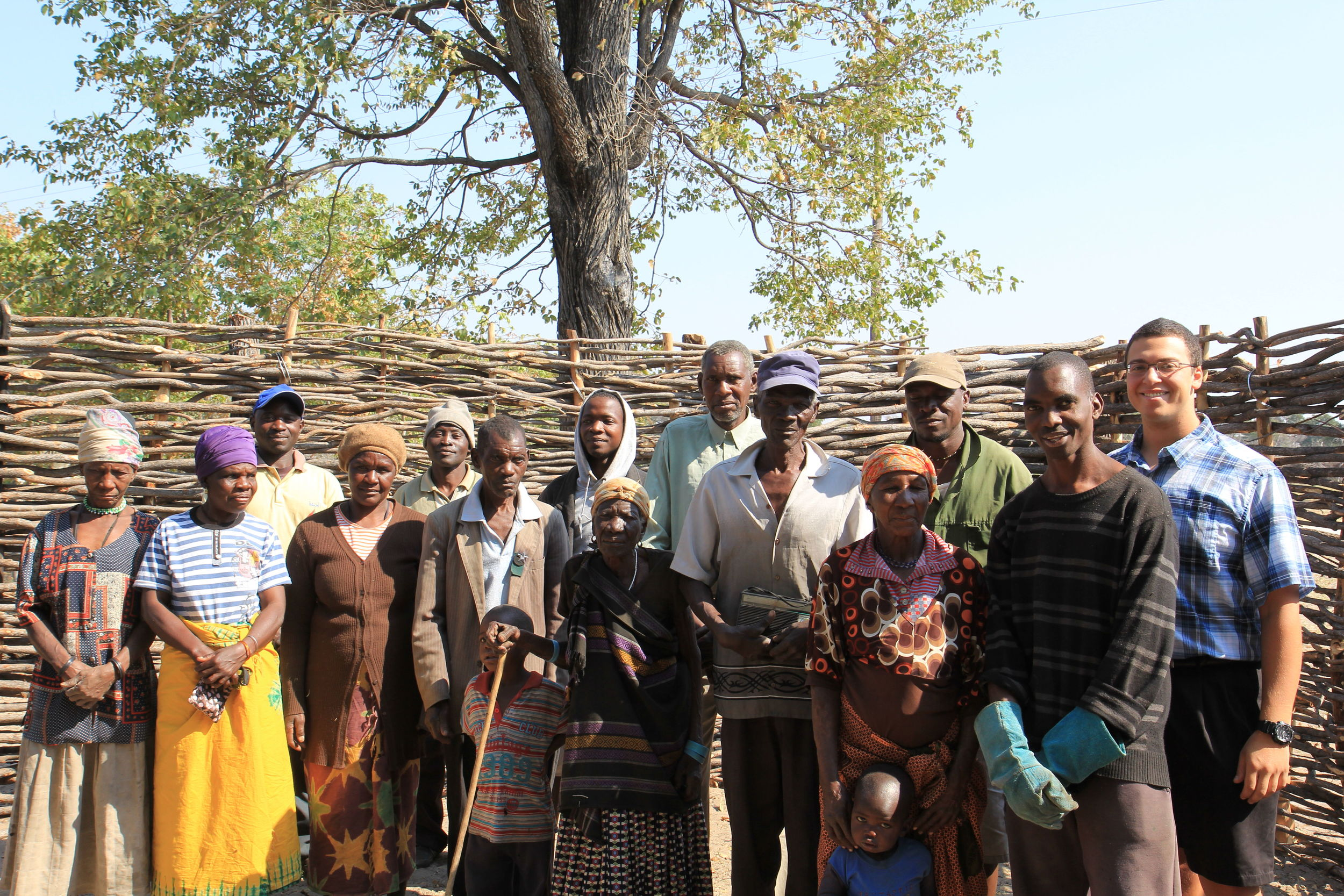 Villagers with Pride in Our Prides staff (Pro and Eric far right) at a kraal turnover ceremony.