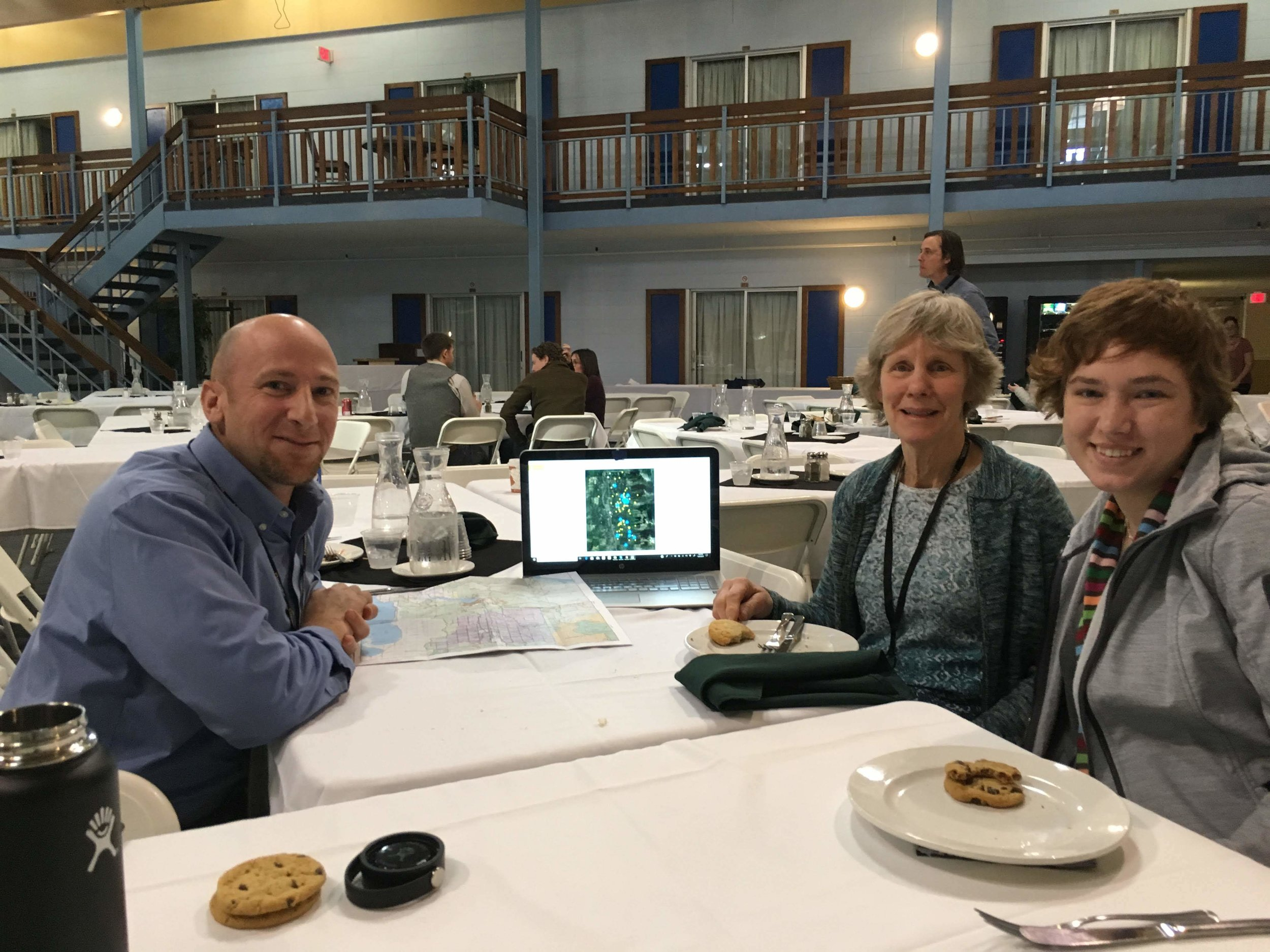 Dr. Andrew Stein, Dr. Diane Boyd and Jenna Brendler discuss the scent marking study at the Living With Wildlife Conference