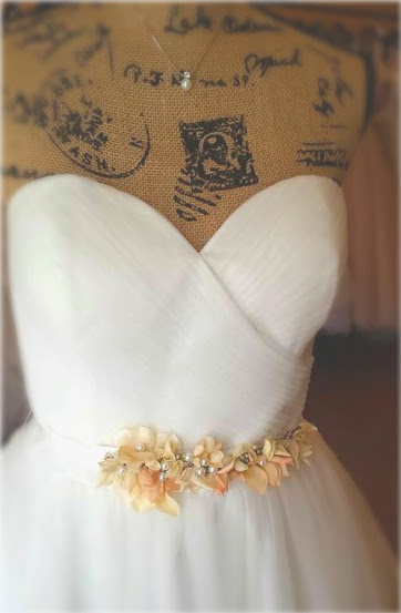 The Alicia Belt is made from Swarovski Crystals, rhinestones, silk hydrangea petals, tea-stained petals, pearls and silk ribbon. It was 100% hand sewn!