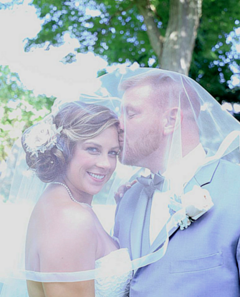Photo Credit: Jess Burhans of Burhans Photos. In this picture we see Amanda's custom Gee June head piece and veil!