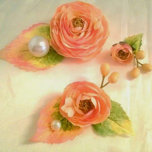 The small and tiny Ranunculus was for the Flower Girl's hair. The large Ranunculus was for the Flower Girl's waist!