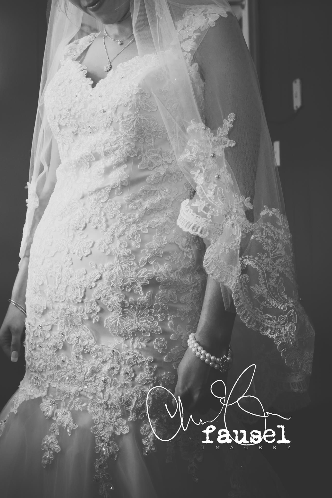 Jessika's veil was made using an Alencon Lace Trim and had hand sewn antique pearls and crystal's sewn into it to match her dress!