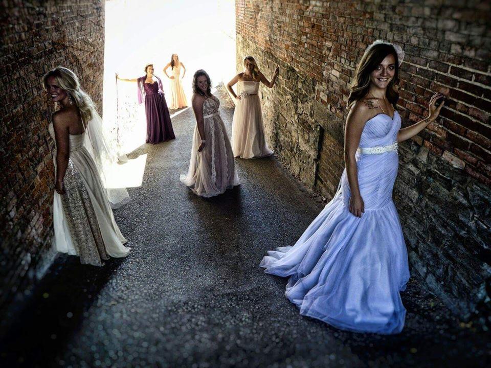 Photography Credit: EmanPhoto, Photographer: Emmanuel Vaucher. Dresses: Bridal Barn. Adornment's: Gee June.