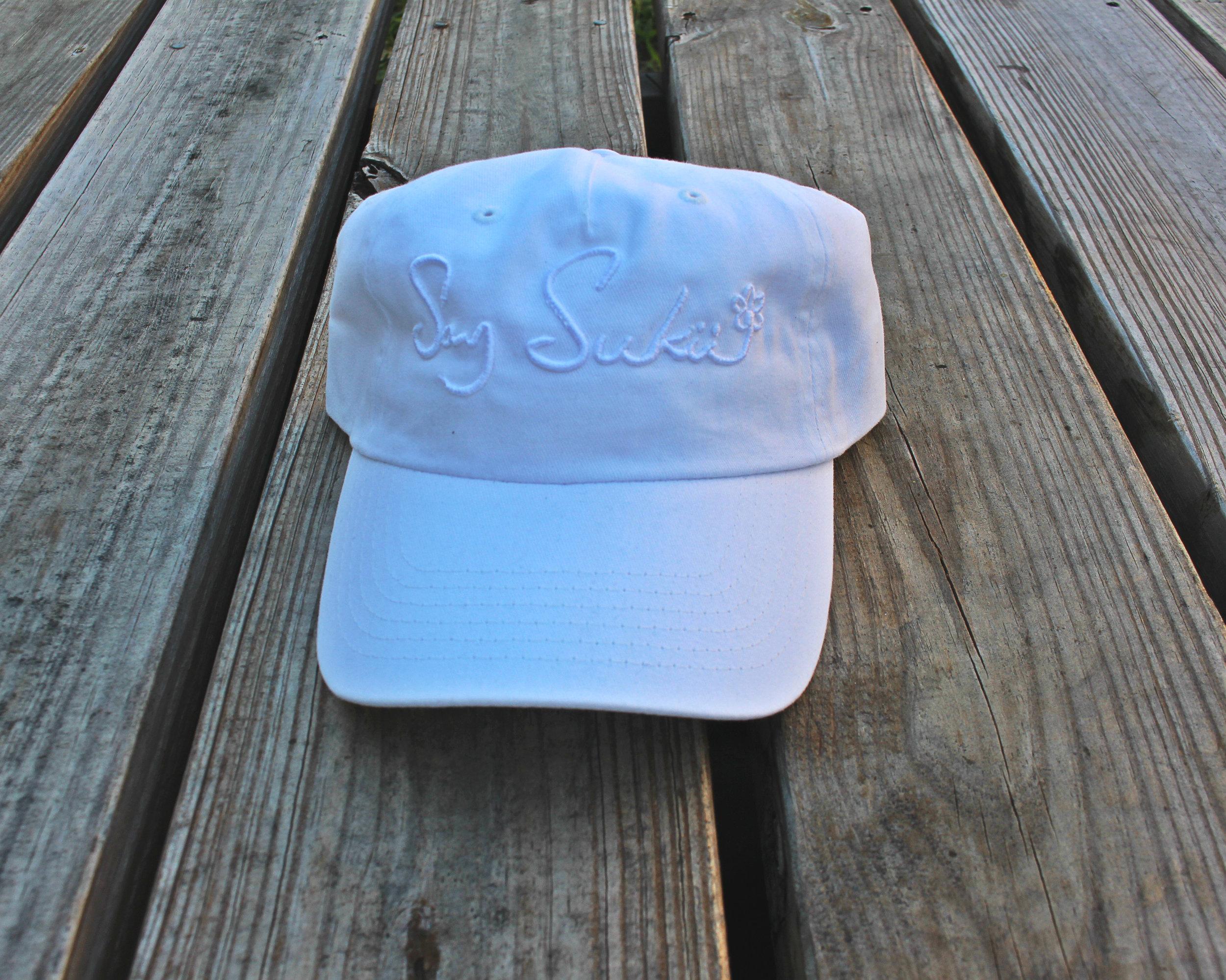 $35  LOGO HAT - WHITE/WHITE   PURCHASE NOW