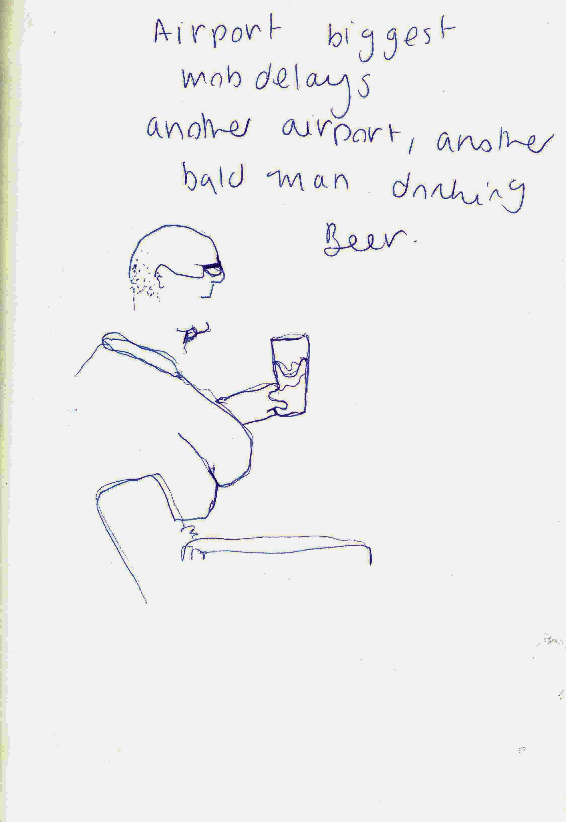 man drinking at airport .jpg