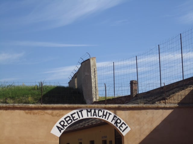 "The Nazi's taunting sign above the Terezin entrance translates as ""Work sets you free."""