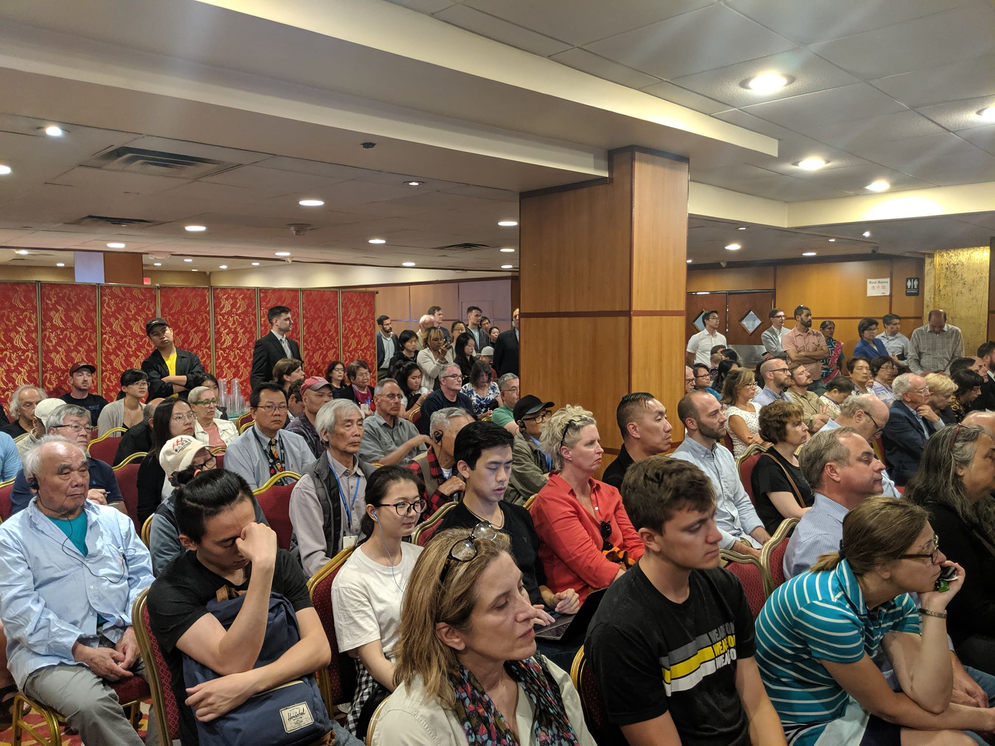 At a June open meeting in Hei La Moon restaurant, Boston Chinatown and Leather District residents opposed the 24-story office building development. A period for public comment has been open since June and closed July 30. (Photo courtesy of Wayne Yeh)