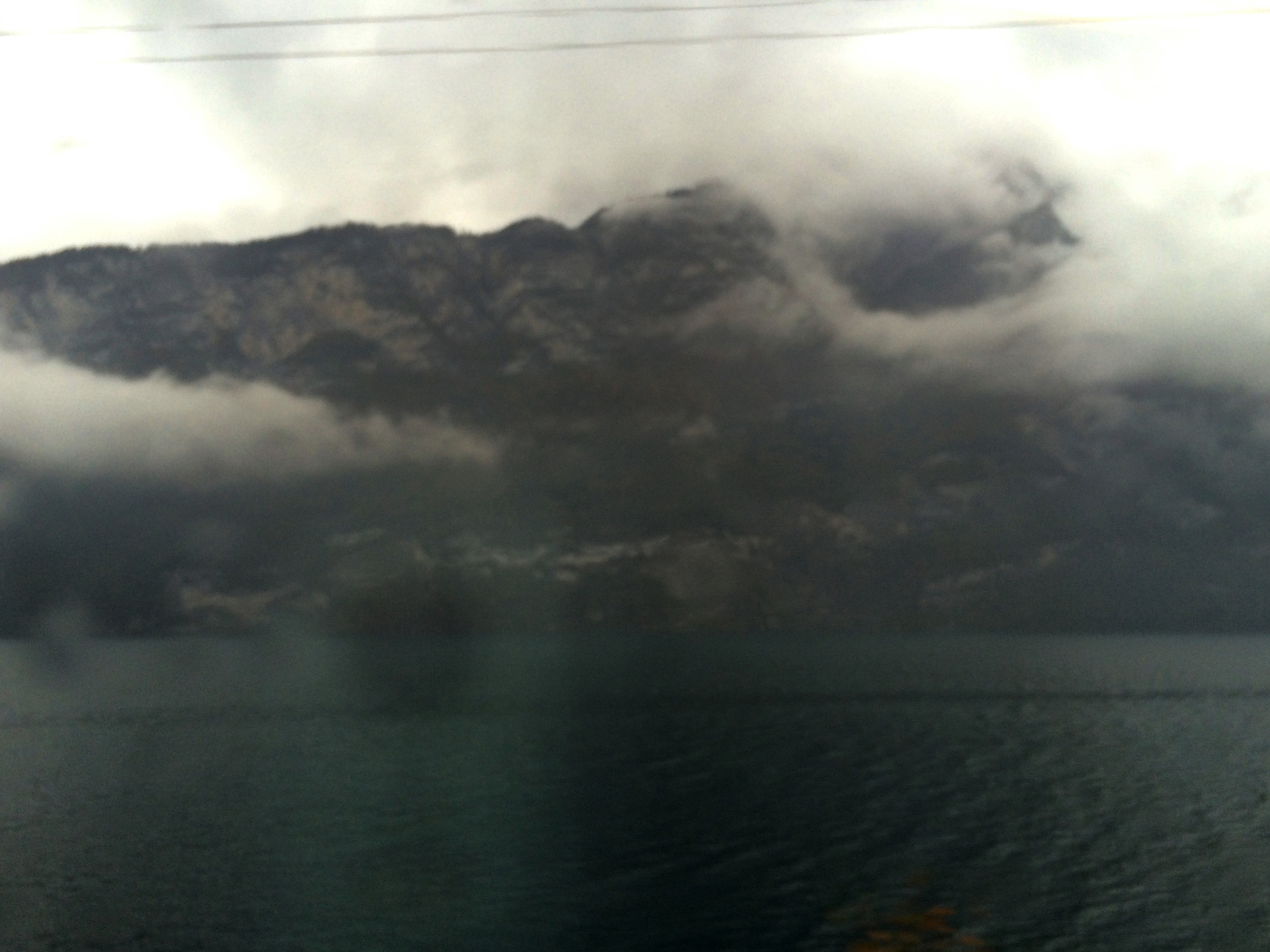 Mountains, clouds,and deep blue waters.