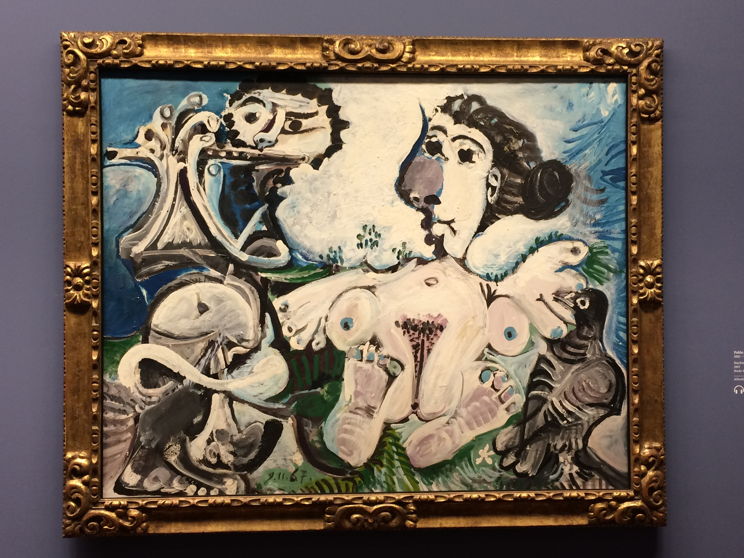 This is a Picasso. But you probably already knew that. Fun thing to think about: Why are they naked in bed with a bird?