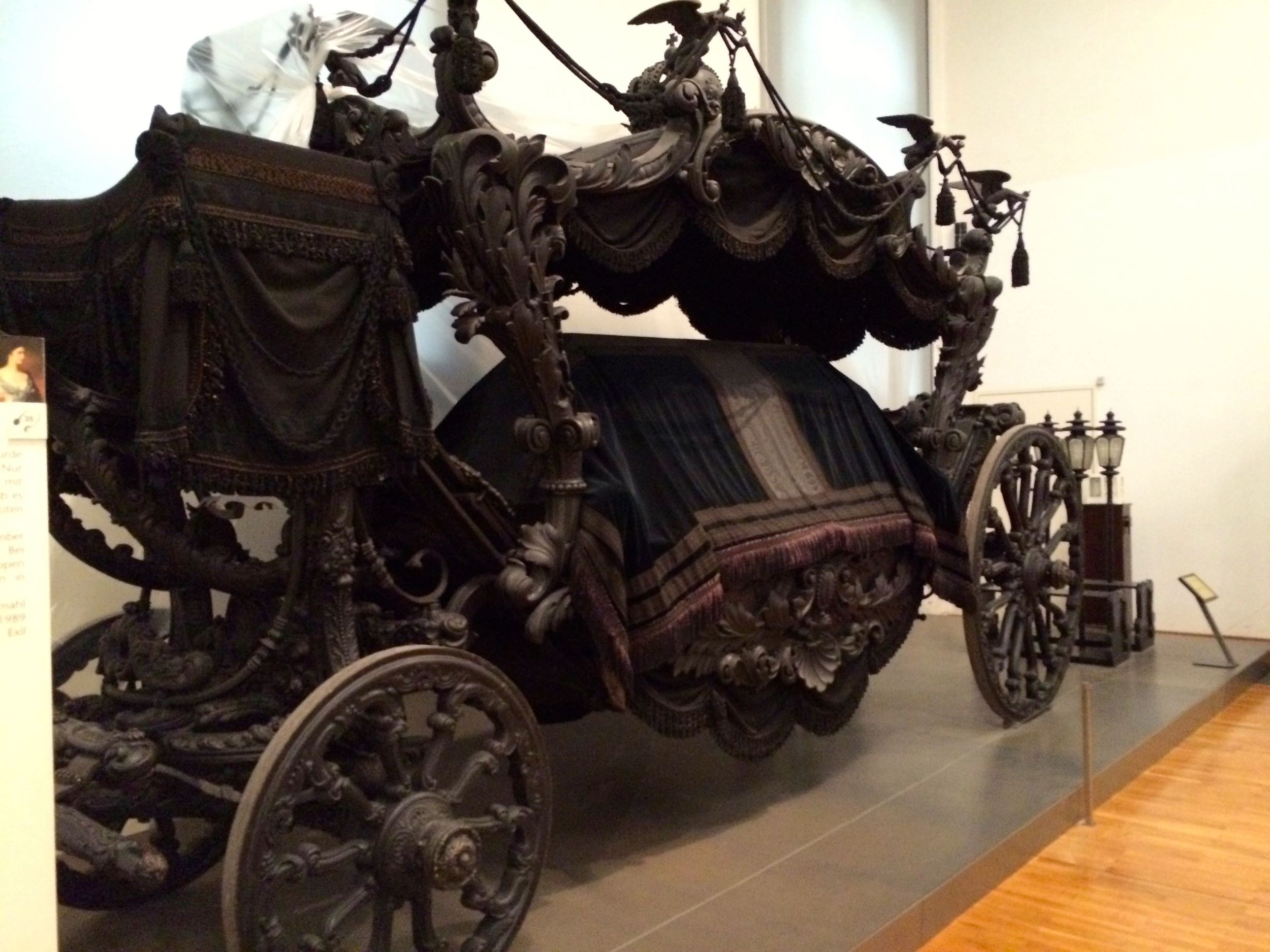 A hearse. Black on black. A tasteful way to mourn.