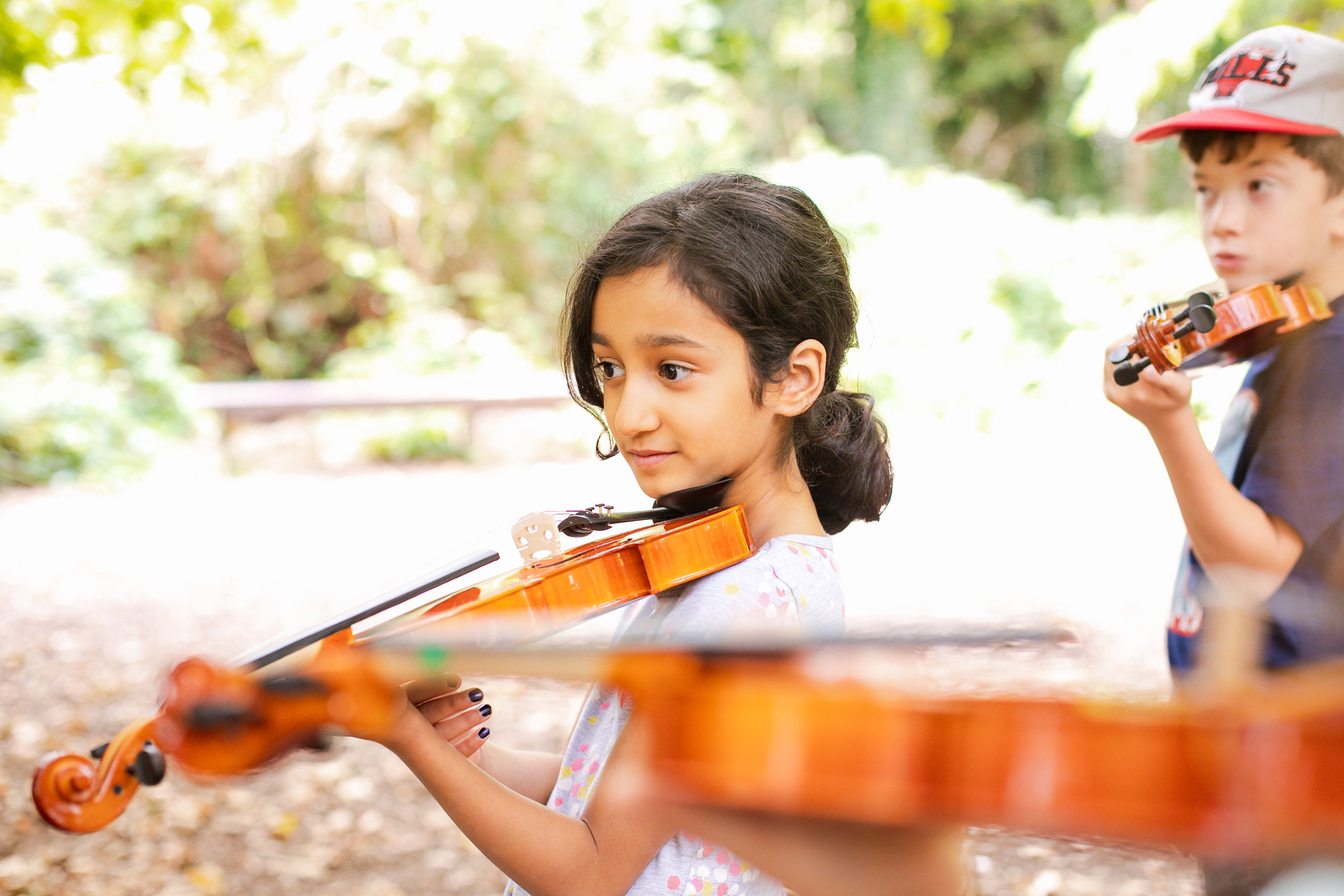 Children tried out instruments such as violin, piano or guitar.  Photo © by Andreas Grieger